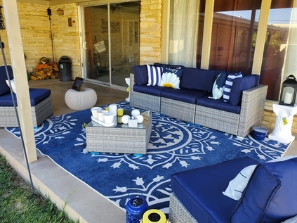 blue patio rug and furniture